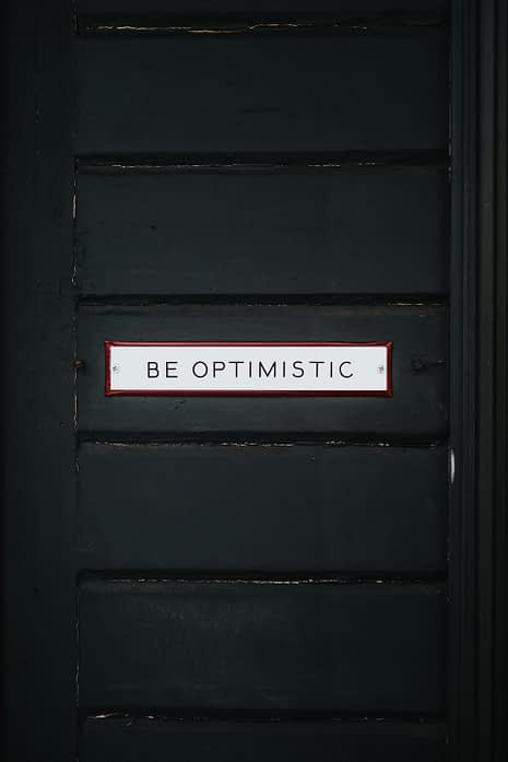 black door with be optimistic overlay