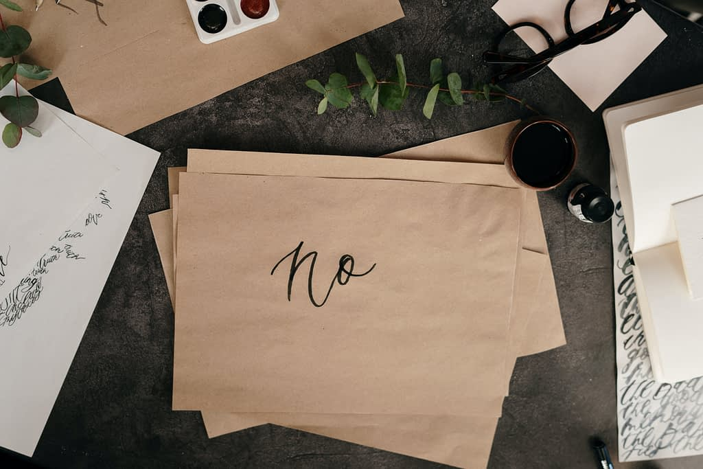 brown paper with handwritten text saying no