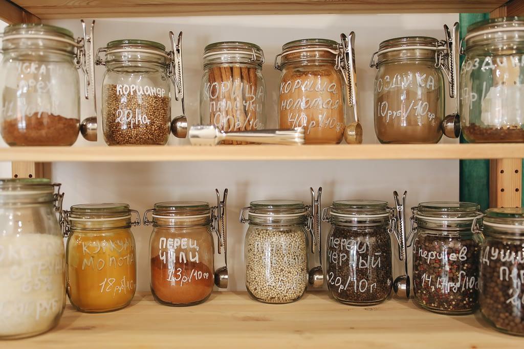 clear glass jar on wooden shelf