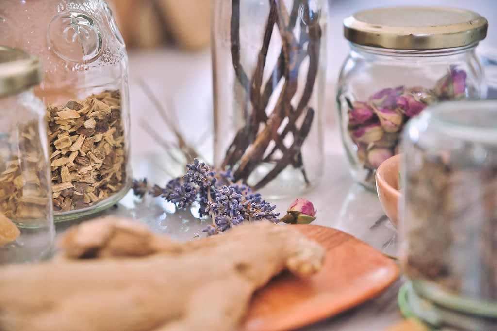 clear glass jars on wooden table