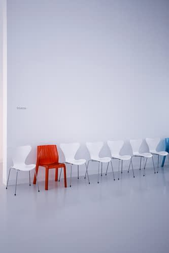 vacant red and white chairs in a room