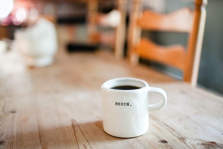 white mug on brown surface