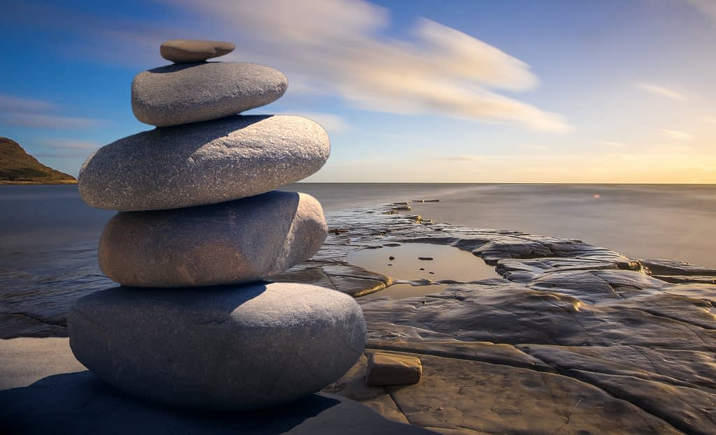 5 stacked boulders on a beach