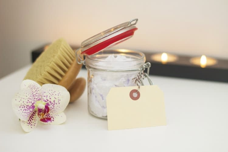 body brush, body scrub and candle