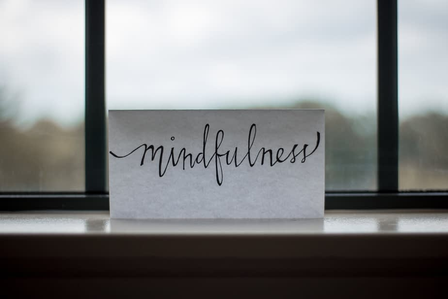 mindfulness printed on piece of paper in front of window